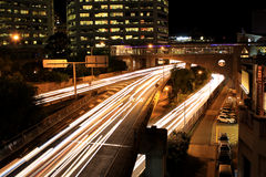 Traffic Flow. Headlight streaks from cars going over a bridge Royalty Free Stock Photo
