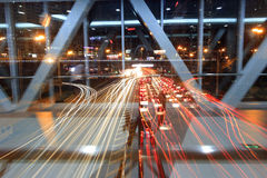 Traffic flow night sight in amoy city,china. Looking road traffic through the glass of coverd footbridge window in the evening Royalty Free Stock Image
