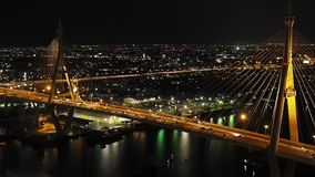 Traffic flow at twilight on the Bhumibol Bridge. In Bangkok Thailand stock video footage