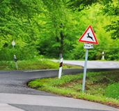Traffic in forest road with deer roadsign Royalty Free Stock Images