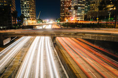 Traffic on the 110 Freeway and buildings in Los Angeles at night Stock Photo