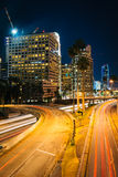 Traffic on the 110 Freeway and buildings in Los Angeles at night Stock Photos