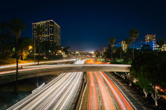 Traffic on the 110 Freeway and buildings in Los Angeles at night Royalty Free Stock Photo