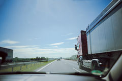 traffic on the freeway with cars and trucks overtaking Stock Images
