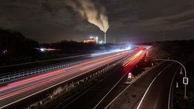 Traffic on freeway A2 near Hannover in Germany at winter night. Timelapse. stock footage