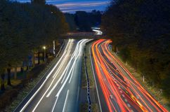 Traffic on a freeway at night in a long exposure stock photography