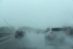 Traffic on the freeway a rainy day. Inside the car royalty free stock images