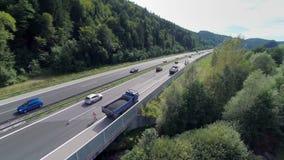 Traffic full of cars, trucks on a bridge stock footage