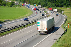 Traffic on german autobahn. Uphill curve Royalty Free Stock Images