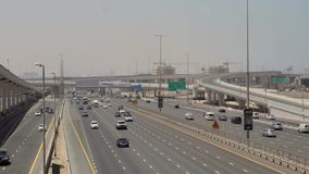 Traffic goes through the streets of Dubai stock footage