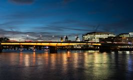 Traffic going over London Bridge royalty free stock images