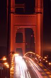 Traffic in Golden Gate Bridge. Traffic through Golden Gate Bridge at night Royalty Free Stock Photos