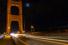 Traffic on Golden Gate Bridge, San Francisco, California. Blur of headlights and taillights from traffic crossing the Golden Gate Bridge in San Francisco Stock Photography