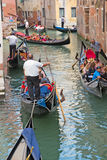 Traffic of gondolas in venetian canal, Italy Stock Photography