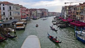 Traffic in Grand Canal seen from Rialto Bridge, Venice, Italy. VENICE, ITALY - APRIL 29: Scenic view with traffic of boats and gondolas in the Grand Canal as stock video footage