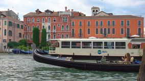 Traffic on Grand Canal in Venice. Venice, Italy - June 14, 2018: Traffic on Grand Canal in Venice Vaporetto, water taxi, gondola stock video