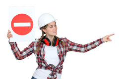 Traffic guard holding a road sign Royalty Free Stock Photos