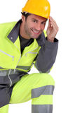Traffic guard touching his hard hat Stock Image
