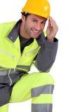 Traffic guard touching his hard hat. Traffic guard / worker touching his hard hat stock image