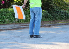 Traffic guide with flag at running race Stock Photo