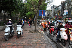 Traffic in Hanoi. Crowd of motorbike drivers on the street Stock Photos