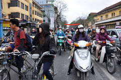Traffic in Hanoi. Crowd of motorbike drivers on the street Stock Image