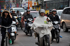 Traffic in Hanoi. Crowd of motorbike drivers on the street Stock Photo