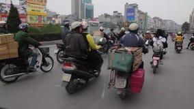 Traffic in Hanoi in Vietnam. Motorbikes traffic in Hanoi, capital of Vietnam, in the winter time stock video