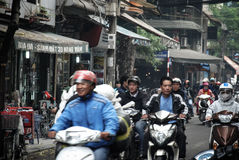 Traffic in  Hanoi, Vietnam. Hanoi Old Quarter, street and traffic with a lot of motorbike Stock Photos