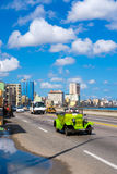 Traffic on the Havana malecon avenue. HAVANA,CUBA - JULY 14,2016 : Street scene with old convertible car on the Havana malecon avenue with a view of the sea and Stock Image
