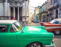 Traffic in Havana. Old colorful cars in the streets of Havana vieja Royalty Free Stock Image