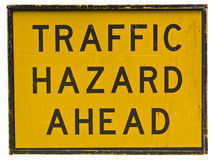 Traffic Hazard Ahead sign. Traffic Hazard Ahead road sign on yellow light reflective surface. Isolated image on white background royalty free stock photography