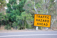 Traffic Hazard Ahead Sign. Yellow traffic hazard sign on the side of a highway or freeway stock photo