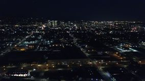 Aerial View of Oakland, California at Night. Traffic is heavy at night on the highways around the city of Oakland, CA. The city is known for its sustainability stock footage