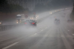 Traffic at heavy rain. Traffic on a motorway at heavy rain royalty free stock image