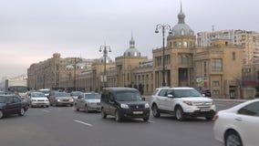 The traffic on Heydar Aliyev Avenue, cloud january evening. Baku, Azerbaijan. BAKU, AZERBAIJAN - SEPTEMBER 05, 2018: The traffic on Heydar Aliyev Avenue, cloud stock footage