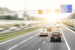 Traffic on the high way. At sunset. Motion blur added Royalty Free Stock Photos