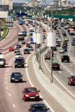 Traffic on the highway of big city. Traffic on the highway of city in a hot summer day Stock Photography