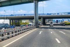 Traffic on the highway in the center of the metropolis. During the day Royalty Free Stock Photo