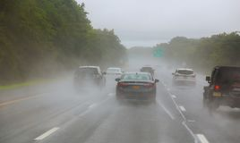 Traffic on highway on a foggy rainy day. Risk of accident during heavy rainfall royalty free stock photo
