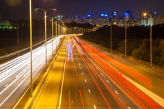 Traffic on the highway leading into the city Royalty Free Stock Photography