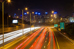 Traffic on the highway leading into the city Royalty Free Stock Image