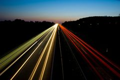 Traffic on a highway at night Royalty Free Stock Photos