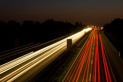 Traffic on a highway at night Stock Images