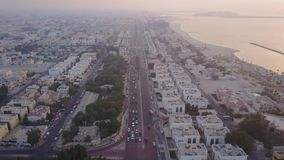 Traffic on highway Sheikh Zayed Road leading to the city center aerial view. Dubai, United Arab Emirates. Top view of. Highway interchange in Dubai 4K stock footage