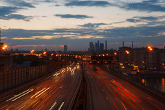 Traffic on the highway at sunset Royalty Free Stock Images