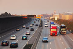 Traffic on a highway. At sunset Stock Photography