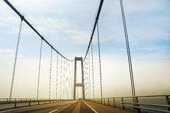 Traffic on the highway. View of the bridge from the car Royalty Free Stock Images