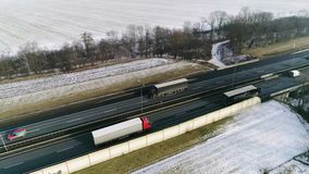 Traffic on highway in winter aerial view. Traffic on highway in winter conditions stock footage