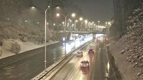 Traffic on highway during winter snow storm. At night stock footage